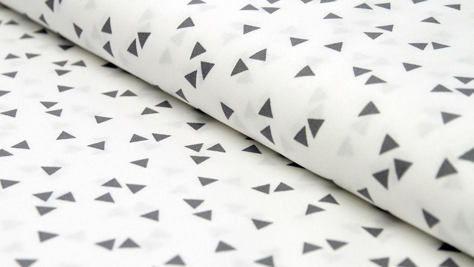 Tissu coton blanc avec triangles gris : Triangle - 150cm dans la mercerie Makerist - Image 1