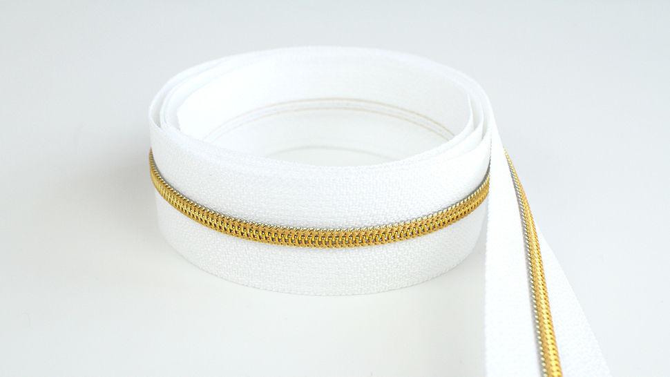 Endlosreißverschluss: gold-weiß - 4 mm  im Makerist Materialshop - Bild 1