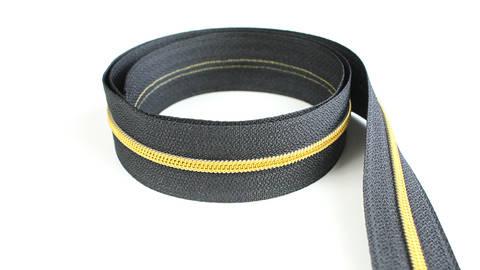 Endlosreißverschluss: gold-schwarz - 4 mm  im Makerist Materialshop