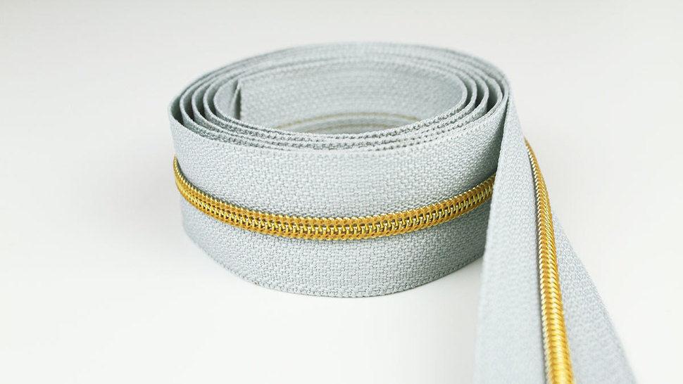 Endlosreißverschluss: gold-grau - 4 mm  im Makerist Materialshop - Bild 1