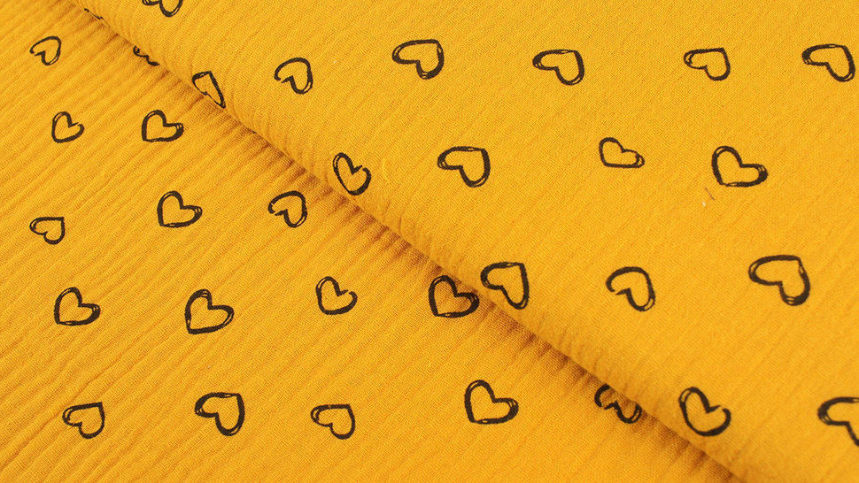 Musselin Baumwollstoff ocker: Herzen - 135 cm im Makerist Materialshop - Bild 1