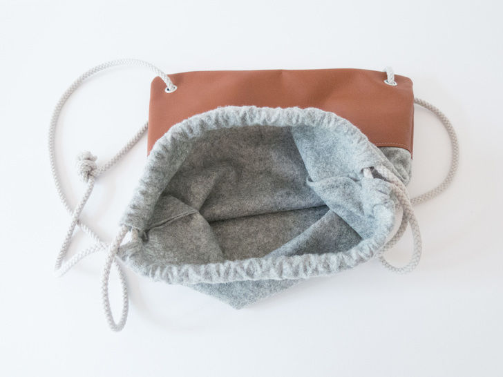 Simple leather and felt drawstring backpack