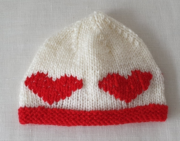 Baby's 8ply beanie with embroidered heart motifs - Kaley