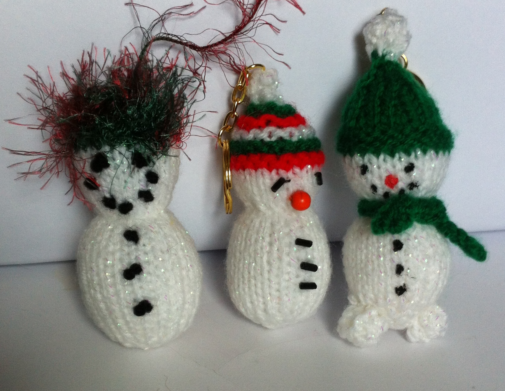 Tiny Snowman knitted keyring/tree ornament.