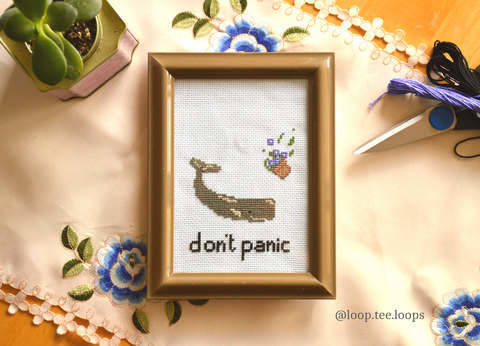 Don't panic, whale and petunias cross stitch.