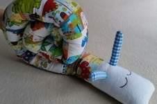 Makerist - Schnecke als Nästchen fürs Baby Bett - 1