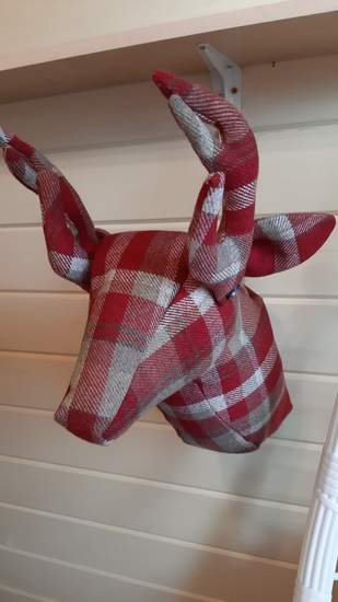 Fabric deer head for an outside (covered) seating area with a hunting lodge theme